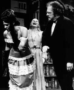 Middle Frank abuses his first wife in 1980 Lawrence production.