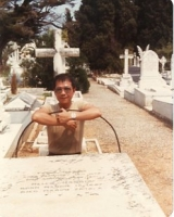 Paul by the grave of Frank Harris in Nice, mid-1980s.