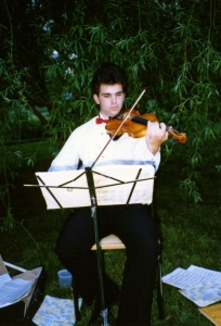 A cellist providing background music at one of Paul's garden parties.