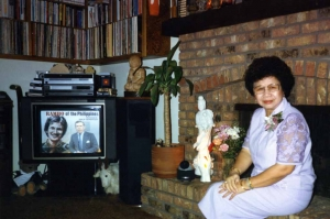 Mom in living room of house, early 1990s.