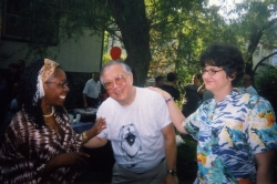 Folabo Ajayi-Soyinka with Paul and Laura Miller at one of Paul's garden parties.
