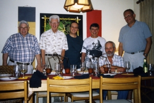 Paul gives a dinner party for John Williams, early 2000s.