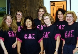 KU English Department secretaries wearing EAT t-shirts, early 1990s.