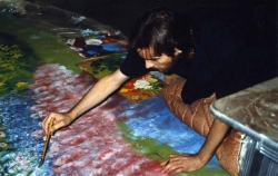 Jim Erdahl painting the backdrop for Two from the Hurt, 1989.
