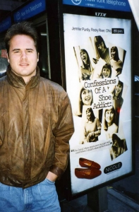 David Scott with street posters in NYC, 1994.