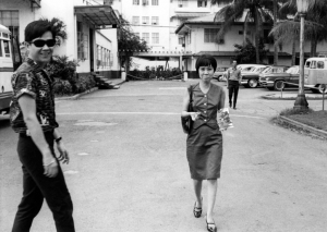 Paul behind the Manila Hotel with Lily Amansec, 1964.