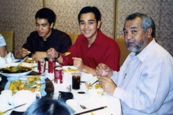 Ray Salvosa and his two sons at dinner party given by Paul, 2005.