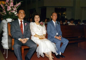 Paul, Mom and Le Leong at Debbie's wedding.