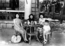 Paul and Mom with Mom's relatives in China, 1948.