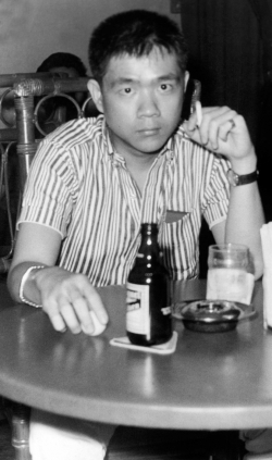 Paul at beer parlor in downtown Manila, mid-1960s.