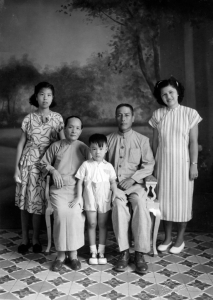 Paul and Mom with Mom's family in China, 1948.