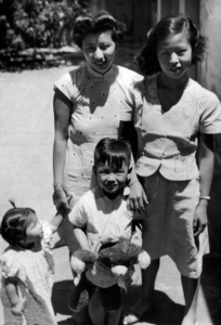 Paul with Mom's relatives in China, 1948.