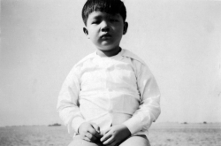 Paul on seawall at Dewey Blvd. by Manila Bay, 1949.