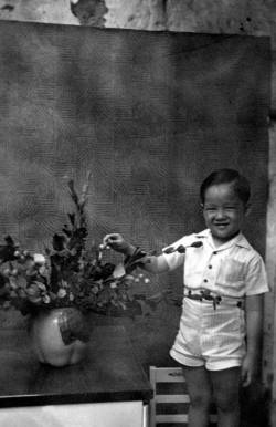 Paul in house in Chinatown in Manila, 1949.
