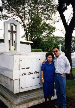 Paul and Mom visit Pop's tomb at Manila Memorial Park, late 1970s.