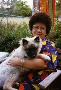 Mom with Imelda in backyard, 1985.