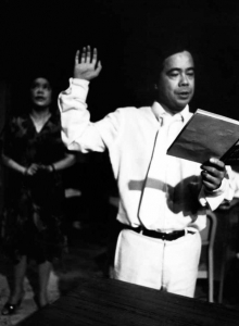 "Alberto Isaac in the ""swearing in"" scene from the play."